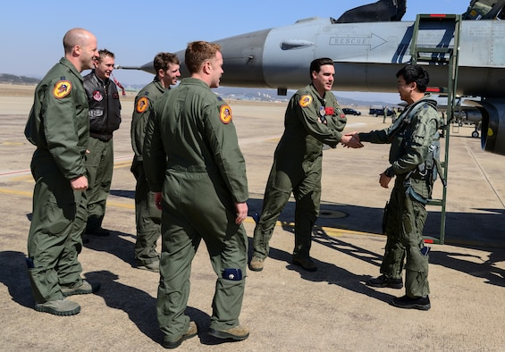 Pilots from the 36th Fighter Squadron meet the Republic of Korea air force pilots participating in Buddy Wing 15-3 March 23, 2015, at Osan Air Base, ROK. The program is intended to enhance the partnership between the United States and ROKAF. (U.S. Air Force photo by Senior Airman Matthew Lancaster)