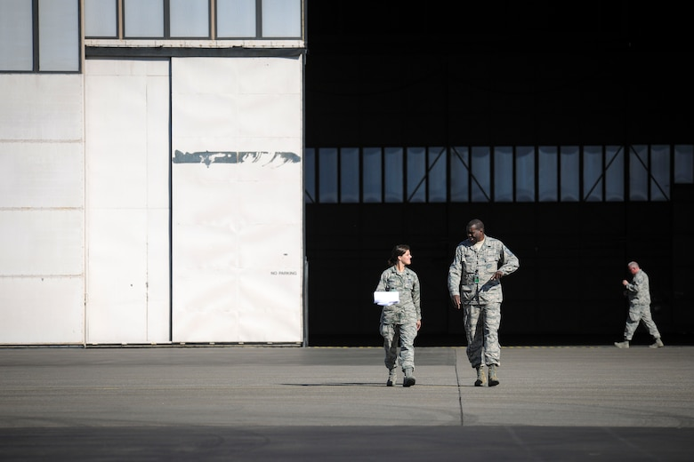 """Airman 1st Class Ashley Almeida and Master Sgt. Kennard Hughes outside """"The Thunderdome"""" at Eielson Air Force Base, Wednesday, May 14, 2015 during Red Flag-Alaska 15-2. (U.S. Air National Guard photo by Capt. Nathan Wallin)"""