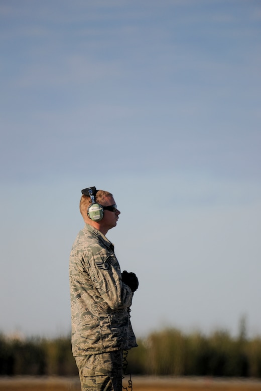 Staff Sgt. Burney Williams, a Crew Chief in 113th Wing's Maintenance Squadron, stands ready on the flight line at Eielson Air Force Base, Tuesday, May 12, 2015 during Red Flag-Alaska 15-2.  (U.S. Air National Guard photo by Capt. Nathan Wallin)