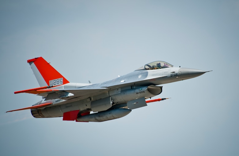 Lt. Col. Ryan Inman, 82nd Aerial Targets Squadron commander, flies a QF-16 across the horizon May 12 at Tyndall Air Force Base, Fla. The QF-16 is a Full Scale Aerial Target that has been modified to be flown with a pilot in the cockpit for training and also without a pilot as a target for live missile testing. The 82nd ATRS received their first QF-16 in September of 2014 and will continue to transition their full scale aerial target program to the new model over the next several months. The 82nd ATRS operates QF-4, QF-16 and BQM-167 targets to provide manned and unmanned aerial targets support for programs across the Department of Defense. (U.S. Air Force photo/Sara Vidoni)