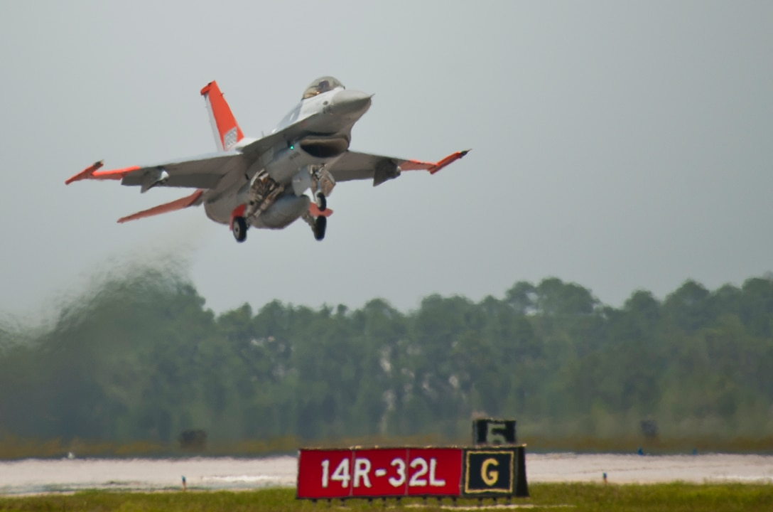 Lt. Col. Ryan Inman, 82nd Aerial Targets Squadron commander, takes off from the runway in a QF-16 May 12 at Tyndall Air Force Base, Fla. The QF-16 is a Full Scale Aerial Target that has been modified to be flown with a pilot in the cockpit for training and also without a pilot as a target for live missile testing. The 82nd ATRS received their first QF-16 in September of 2014 and will continue to transition their full scale aerial target program to the new model over the next several months. The 82nd ATRS operates QF-4, QF-16 and BQM-167 targets to provide manned and unmanned aerial targets support for programs across the Department of Defense.  (U.S. Air Force photo/Sara Vidoni)
