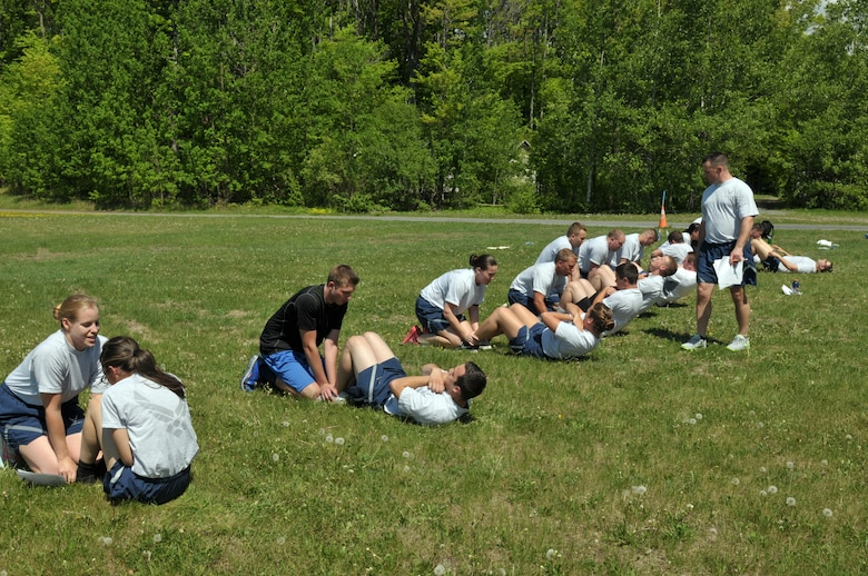 Trainees with the 109th Student Flight perform a mock physical training test May 17, 2015, at Stratton Air National Guard Base, New York. Regular PT is just one of many changes the Student Flight recently underwent to help ensure 100-percent graduation at Basic Military Training. (U.S. Air National Guard photo by Master Sgt. Christine Wood/Released)