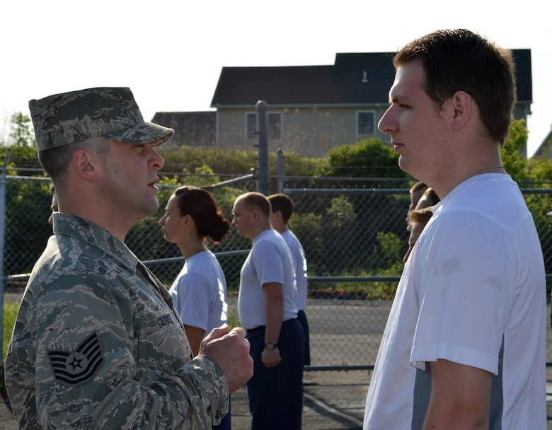Tech. Sgt. Michael Crouse tells Trainee Bradley Collyer what the grooming standards are within the Air Force during an inspection of the 109th Student Flight on May 17, 2015, at Stratton Air National Guard Base, New York. This was Collyer's first Unit Training Assembly. Inspections are just one of many changes the Student Flight recently underwent to help ensure 100-percent graduation at Basic Military Training. Crouse, 139th Aeromedical Squadron, is one of three cadre assigned to the flight. (U.S. Air National Guard photo by Tech. Sgt. Catharine Schmidt/Released))