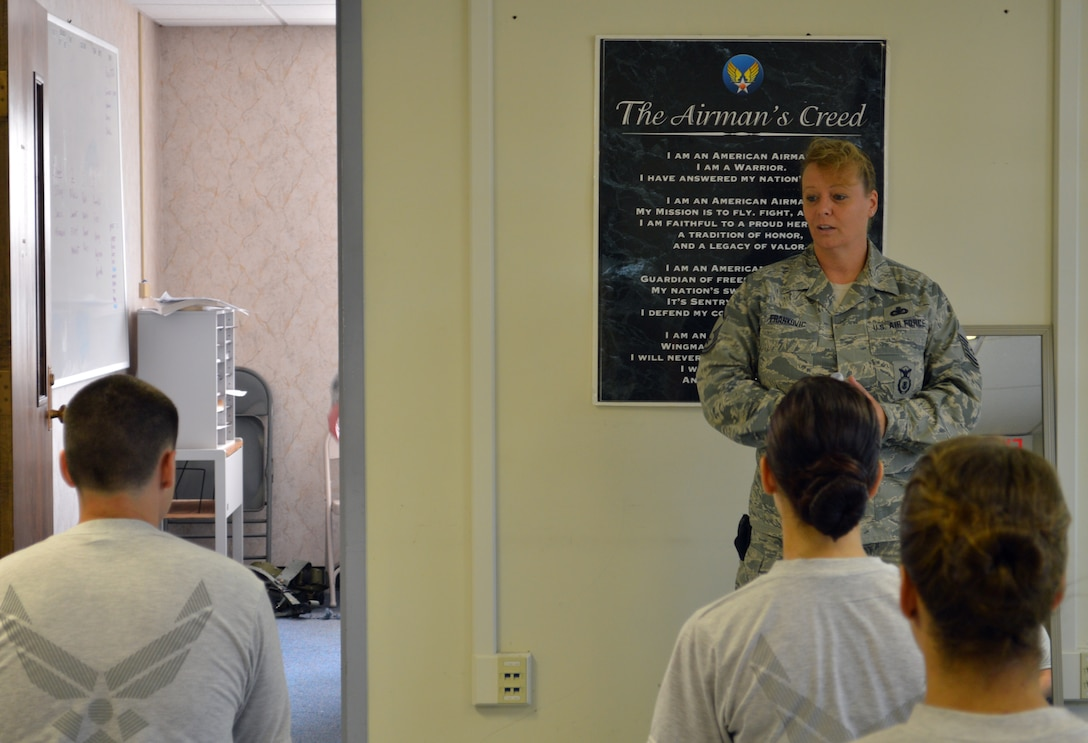 Master Sgt. Marlene Frankovic talks to the 109th Student Flight about dress and appearance May 17, 2015, at Stratton Air National Guard Base, New York. Frankovic, 109th Security Forces Squadron, is one of three cadre assigned to the flight, which recently underwent many changes to help ensure 100-percent graduation at Basic Military Training. (U.S. Air National Guard photo by Tech. Sgt. Catharine Schmidt/Released)