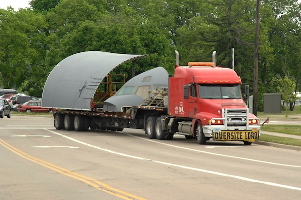 Disassembled sections of a C-17 cargo plane were delivered by truck to Wright-Patterson Air Force Base, Ohio the morning of May 18, 2015. The pieces are bound for the United States School of Aerospace Medicine (USAFSAM) and the co-located Air Mobility Command (AMC) Detachment 4, Formal Training Unit (FTU) for reassembly into an Aeromedical Evacuation (AE) training station.  (U.S. Air Force photo by Al Bright / Released)