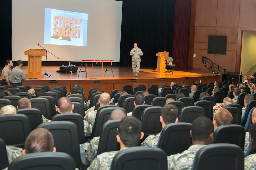 Col. Jeffrey DeVore, Joint Base Charleston commander, briefs members of JB Charleston on the importance of safety practices during the annual Street Smart safety briefing, May 14, 2015 at the Air Base Theater. The briefing contained detailed videos and demonstrations on practicing good safety and using common sense to prevent serious injury or death. (U.S. Air Force photo/Senior Airman George Goslin)