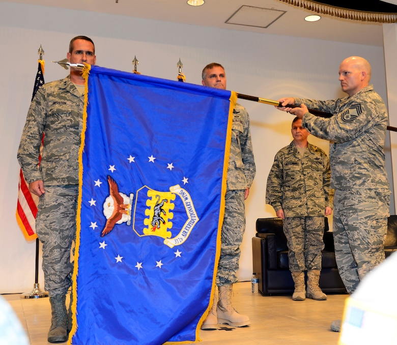The 332nd Air Expeditionary Wing guidon was unfurled during an activation and assumption of command ceremony at an undisclosed location in Southwest Asia May 19, 2015. The 332nd AEW has a distinguished lineage, which includes the 332nd Air Expeditionary Group, the famed Tuskegee Airmen, also known as the Red Tails. (U.S. Air Force photo by Senior Airman Racheal E. Watson)