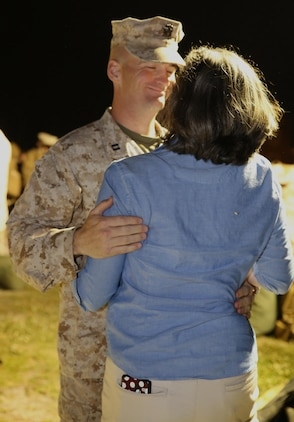 Navy Lt. Doyl E. McMurry, Ground Combat Element Integrated Task Force chaplain, embraces his wife after returning to Marine Corps Base Camp Lejeune, North Carolina, May 20, 2015, from a three-month assessment at Marine Corps Air Ground Combat Center Twentynine Palms and Marine Corps Mountain Warfare Training Center Bridgeport, California. From October 2014 to July 2015, the GCEITF conducted individual and collective level skills training in designated ground combat arms occupational specialties in order to facilitate the standards-based assessment of the physical performance of Marines in a simulated operating environment performing specific ground combat arms tasks. (U.S. Marine Corps photo by Sgt. Alicia R. Leaders/Released)