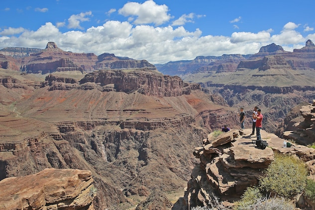 Marines take a scenic view of the Grand Canyon at a plateau during the Single Marine Program Grand Canyon Trip, May 16.The Single Marine Program offers trips to different recreational destinations such as Big Bear Lake, the Grand Canyon, Las Vegas and San Francisco. For more information on the available programs, please visit http://www.mccscp.com/smp