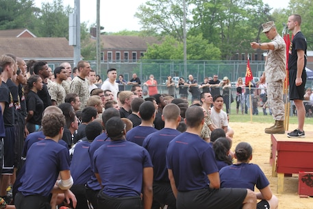 Staff Sgt. Khanh H. Nguyen, supply chief for Recruiting Station New Jersey, teaches a few dozen poolees how to properly stand at attention during the 2015 Annual Pool Function aboard Naval Weapons Station Earle in Colts Neck, N.J., May 16, 2015.
