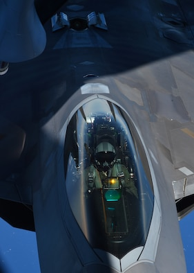 A pilot from the Hawaiian Raptors guides the F-22 Raptor into position during aerial refueling operations with the 96th Air Refueling Squadron's KC-135R Stratotanker over Hawaii, May 19, 2015. The F-22 is the Air Force's fifth generation fighter aircraft. (U.S. Air Force photo by Tech. Sgt. Aaron Oelrich/Released)