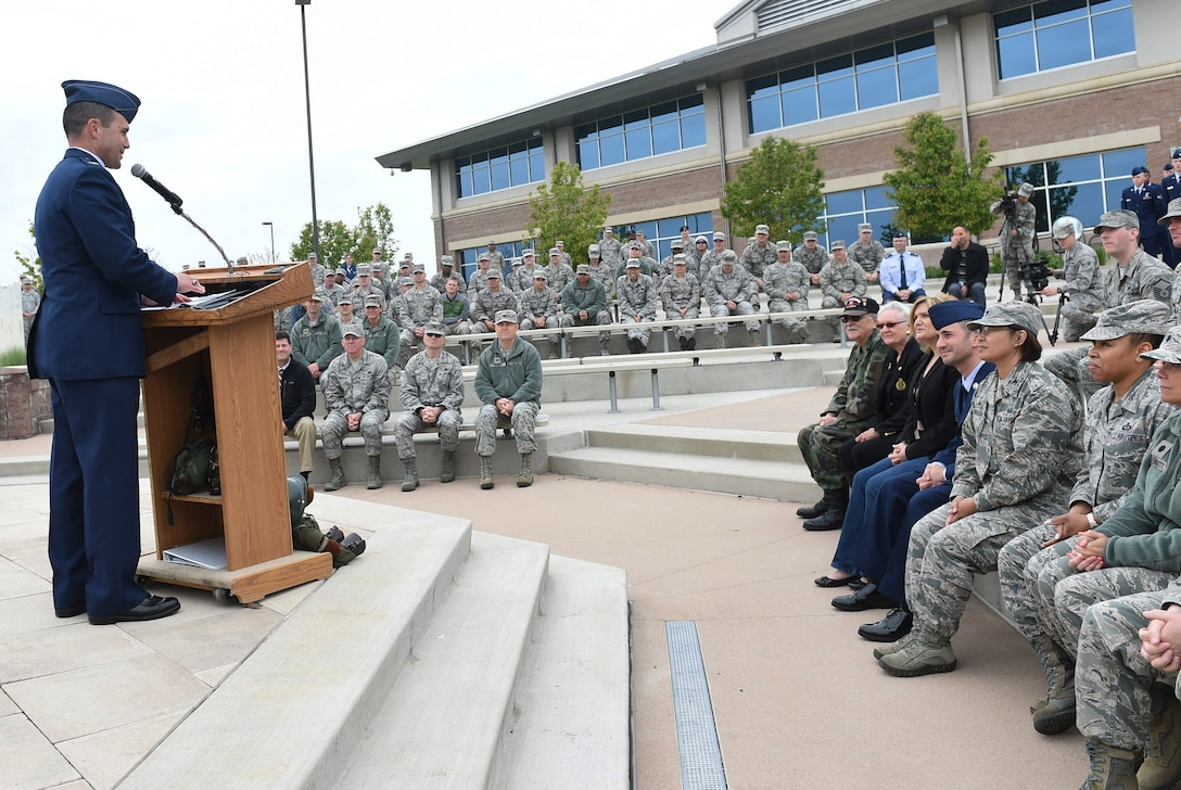 Col. John Wagner, 460th Space Wing commander, speaks during a Memorial Day ceremony May 21, 2015, at the headquarters building on Buckley Air Force Base, Colo. The ceremony included a formation, a guest speaker and a retreat ceremony. (U.S. Air Force photo by Airman 1st Class Samantha Meadors/Released)
