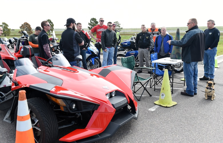 """Donald Wood, 460th SCS information technology specialist, second from right; gives a safety briefing before their motorcycle safety ride May 15, 2015, on Buckley Air Force Base, Colo. The 460th SCS had this motorcycle ride to give """"on-the-job"""" training to ensure young members of the squadron know how to ride safely. (U.S. Air Force photo by Airman 1st Class Emily E. Amyotte/Released)"""