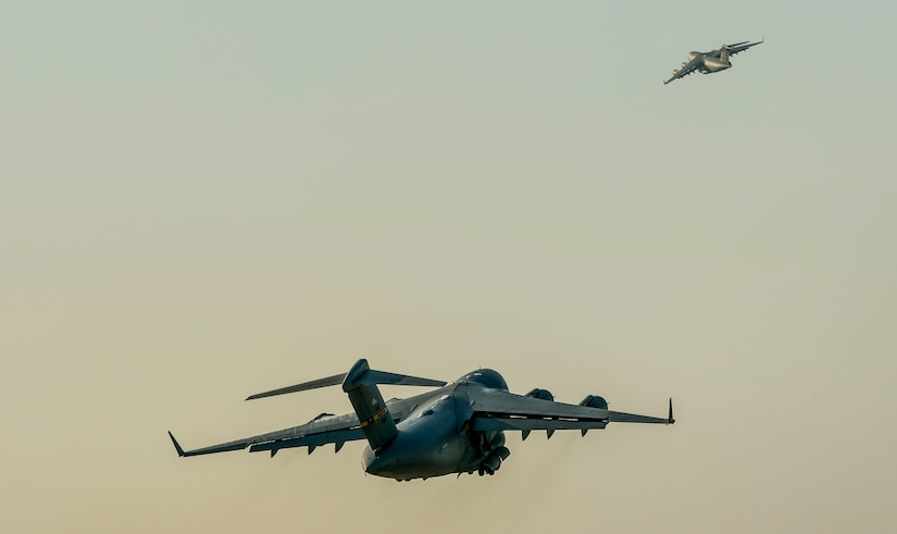 U.S. Air Force C-17 Globemaster III's take off from Joint Base Charleston, S.C. May 21, 2015 during exercise CRESCENT REACH 15. This exercise tested and evaluated Joint Base Charleston's ability to launch a large aircraft formation in addition to processing and deploying duty passengers and cargo in response to a simulated crisis abroad. The 437th Airlift Wing launched 11 aircraft as part of the multi-ship formation that flew to Pope AFB, North Carolina. There they joined four additional C-17s, six C-130s, E-8 JSTARS and two F-16s to participate in the 82nd Airborne Division's All American Week. During their time there, more than 1,400 paratroopers and critical equipment, such as HUMVEES and artillery, were dropped to simulate a Joint Forcible Entry of the Global Response Force. All American Week is the Division's premiere event to maintain close ties with Division Veteran's as well as celebrate heritage and unit cohesion. (U.S. Air Force photo by Senior Airman Nicholas Byers)