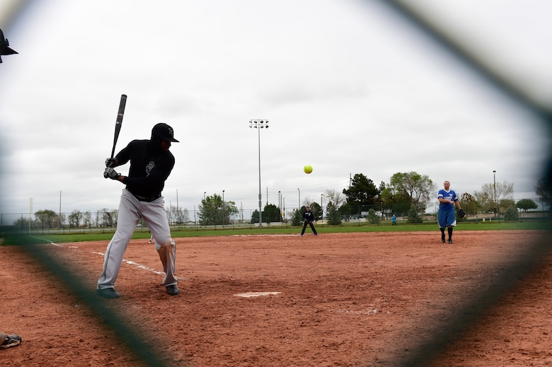A softball player waits to hit the ball during the Tri-Wing Sports Day competition May 20, 2015, on Buckley Air Force Base, Colo. Tri-Wing Sports Day is held once a year between the three bases and is intended to promote healthy, active lifestyles and friendly competition. The bases competed against each other in over 15 sports such as volleyball, football, tennis and softball among others. (U.S. Air Force photo by Staff Sgt. Stephany Richards/Released)