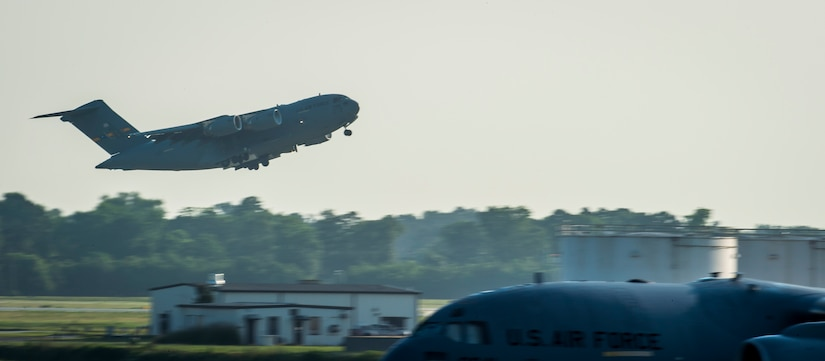 A C-17 Globemaster III takes off May 21, 2015, at Joint Base Charleston, S.C. during exercise Crescent Reach 2015. The exercise tested JB Charleston's ability to launch a large aircraft formation and mobilize a large amount of cargo and passengers. (U.S. Air Force photo/Senior Airman Jared Trimarchi)