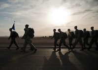 Airmen assigned to the 99th Security Forces Squadron participate in a 10K memorial ruck march for National Police Week at Nellis Air Force Base, Nev., May 13, 2015. The march was one of many events held at Nellis AFB to honor the sacrifices of both military and civilian law enforcement members. (U.S. Air Force photo by Staff Sgt. Siuta B. Ika)