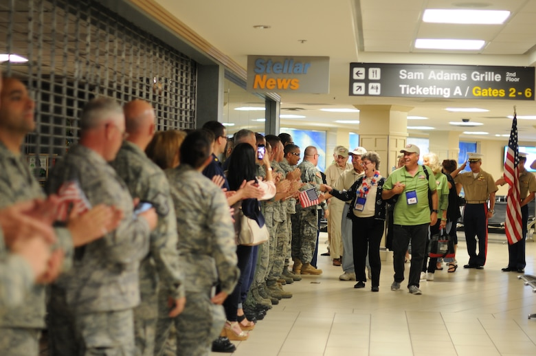 U.S. Air Force Airmen from the New Jersey Air National Guard's 177th Civil Engineering Squadron came together with fellow military service members and people from the community to line the halls of Clearwater International Airport, Fla. to welcome home veterans of World War II on May 19, 2015. The honor flight was returning from a trip to Washington D.C. to visit war memorials.  (U.S. Air National Guard photo by Airman 1st Class Amber Powell/Released)