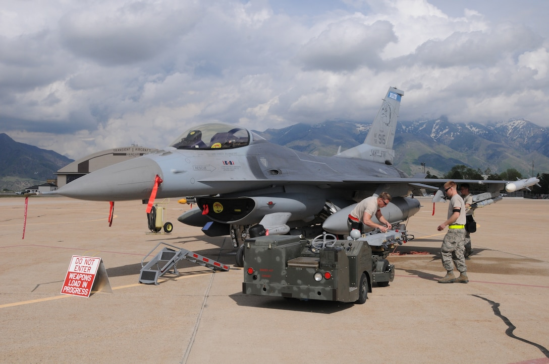 Weapon Loaders, 148th Fighter Wing, Duluth, Minn. load weapons on Block 50, F-16's for Combat Hammer, May 5, 2015 while at Hill AFB, Utah.  Combat Hammer is a Weapons System Evaluation Program (WSEP) that evaluates the entire weapon process, from build-up to employment.  (U.S. Air National Guard photo by Master Sgt. Ralph Kapustka)