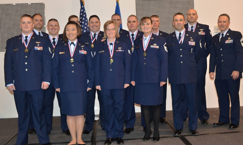U.S. Air Force Airmen assigned to the 153rd Airlift Wing, Wyoming Air National Guard, pose for a picture prior to the Community College of The Air Force Graduation ceremony May.02, 2015 at  F.E. Warren AFB in Cheyenne, Wyoming. (U.S. Air National Guard photo by Tech. Sgt. John Galvin/released)