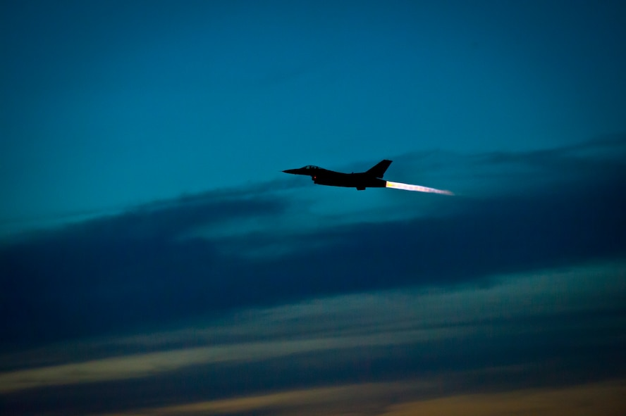 An F-16 Fighting Falcon takes off at Holloman Air Force Base, N.M. May 13, 2015. The 311th Fighter Squadron, a tenant unit from Luke Air Force Base, Ariz., trains F-16 pilots at Holloman. The students are currently at a point in their syllabus where they are learning how to use night vision goggles and perform combat night operations.  (U.S. Air Force photo by Airman 1st Class Emily A. Kenney/Released)