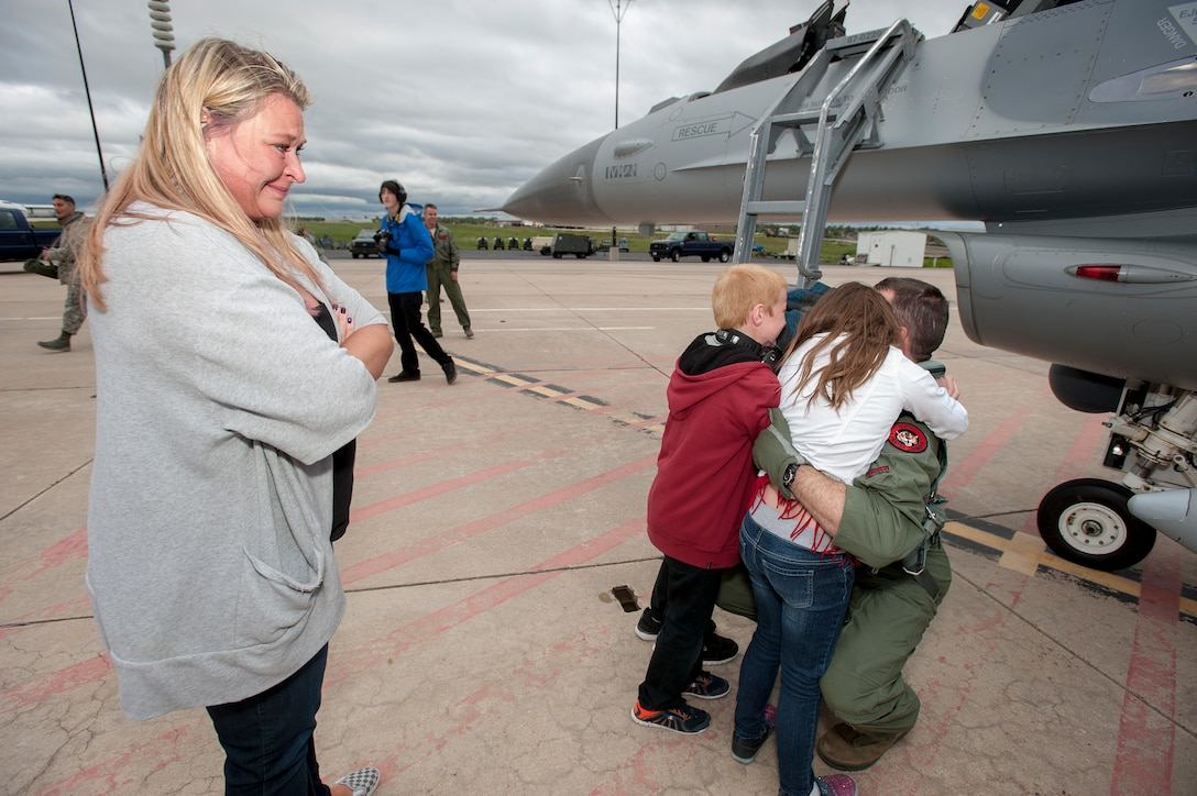 """U.S. Air Force Lt. Col. Kurt Tongren???s family welcomes him home after landing an F-16 Fighting Falcon from the 120th Fighter Squadron, Colorado Air National Guard, at Buckley Air Force Base, Colo., upon his return from a deployment to the Republic of Korea, May 19, 2015. Integrating with other U.S. Air Force members, flying daily training mission and providing a Theater Security Package for the past 90 days, this return home marks the completion of the seventh deployment for the """"Redeyes"""" of the 120th FS along with the 140th Wing since Sept. 11, 2001. (U.S. Air National Guard photo by: Tech. Sgt. Wolfram M. Stumpf/RELEASED)"""