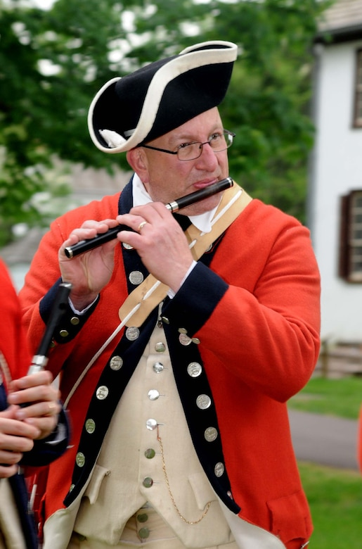 Nick Sciarrotta of the Old Barracks Fife and Drum Corps, a part of the Friends of Washington Crossing Park Reenactors, plays the fife during the distinguished service award dinner for retired Maj. Gen. Wesley Craig May 16, 2015, Washington Crossing Historic Park, Washington Crossing, Pennsylvania. Craig, formerly The Adjutant General of the Pennsylvania National Guard, was presented with the 2015 Mary G. Roebling Award. (U.S. Air National Guard photo by Tech. Sgt. Andria Allmond/Released)