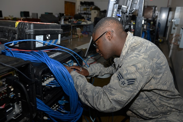 Senior Airman Shameer Goss, 644th Combat Communications Squadron network administrator, logs into a deployable network server to ensure it is in working condition May 12, 2015, at Northwest Field, Guam. The unit is tasked with providing communication for a site that can range anywhere from 50 to 3,000 members, depending on operational needs. (U.S. Air Force photo by Airman 1st Class Arielle Vasquez/Released)