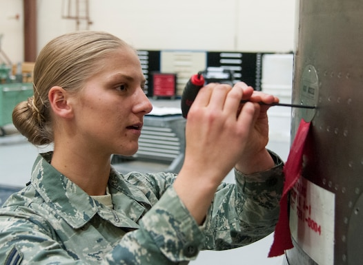 Airman 1st Class Alexis Visser, 90th Munitions Squadron reentry system/reentry vehicle team member, makes adjustments to the aft shroud of a Minuteman III ICBM on F.E. Warren Air Force Base, Wyo., May 19, 2015. Maintainers such as Visser require months of training before they can be certified to perform real maintenance operations. (U.S. Air Force photo by Senior Airman Jason Wiese)