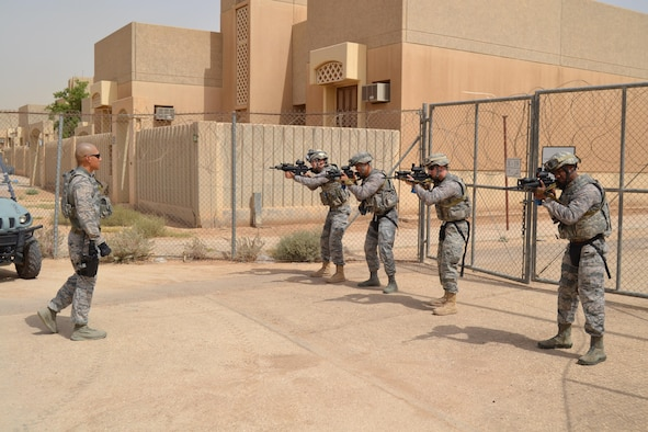 Airmen from the 879th Expeditionary Security Forces Squadron train active shooter neutralization tactics as part of the Air Force Central Command initiative  'Check Six' May 19, 2015 at Eskan Village, Saudi Arabia. Eskan Village is a housing community home to the United States military training mission to Saudi Arabia, a vital part of the strategic relationship between the United States and the Kingdom of Saudi Arabia. The 879th Expeditionary Security Forces Squadron is the 379th Air Expeditionary Wing's only geographically separated unit. (U.S. Air Force photo/ Senior Airman Kristopher Bennett)