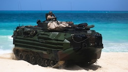 Amphibious Assault Vehicles, launched from the USS Rushmore, demonstrated amphibious landings as part of the U.S. Pacific Fleet's joint sea-basing exercise, Culebra Koa 15, May 19, 2015, aboard Marine Corps Training Area Bellows. Observed by local-based military and representatives from 22 countries within the Indo-Asia-Pacific region, the landing was made in conjunction with the inaugural U.S. Marine Corps Forces Pacific-hosted U.S. Pacific Command Amphibious Leaders Symposium.