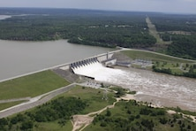 Aerial view of water being released from the Lake Eufaula Dam, May 13, 2015, at a rate of approximately 48,000 cubic feet per second. The flood control area behind the dam is normally kept empty. Currently, flood waters at the Lake Eufaula Dam, in Oklahoma are at 116 percent of capacity and operating over the flood pool into the surcharge pool.
