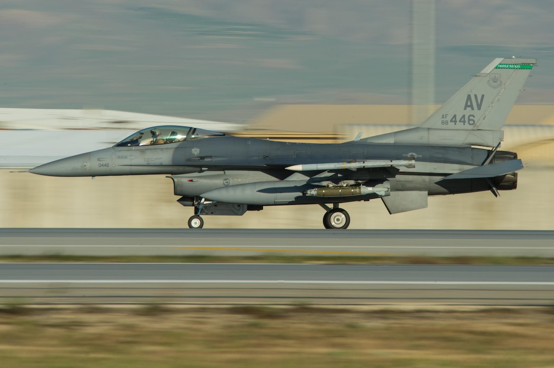 An F-16 Fighting Falcon, assigned to the 555th Expeditionary Fighter Squadron at Aviano Air Base, Italy, lands at Bagram Airfield, Afghanistan, May 13, 2015. The F-16 is a multi-role fighter aircraft that is highly maneuverable and has proven itself in air-to-air and air-to-ground combat. Members of the 555th EFS are deployed in support of Operation Freedom's Sentinel and NATO's Resolute Support mission. (U.S. Air Force photo/Tech. Sgt. Joseph Swafford)