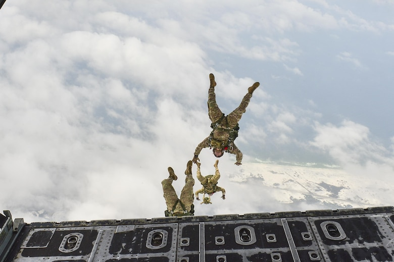 Members of the 7th Special Forces Group perform a high-altitude, low-opening jump from an MC-130P Combat Shadow over Hurlburt Field, Fla., May 15, 2015. The final two Combat Shadows in the Air Force landed for the last time at Hurlburt Field in front of more than 400 people. The two aircraft will take their last flight to the boneyard at Davis-Monthan Air Force Base, Ariz., June 1. (U.S. Air Force photo/Senior Airman Jeff Parkinson)