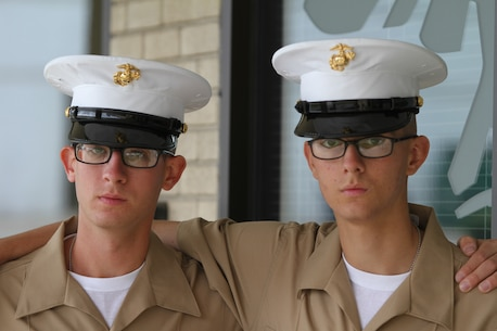 "Nathan (right) and Michael (left)  Wilson graduated recruit training on May 8 at Marine Corps Recruit Depot Parris Island, South Carolina. Michael was scheduled to ship off to recruit training March 23, 2015, but instead he shipped off early on February 9. ""Staff Sgt. Rondini (Marine in charge of Recruiting Substation York) called me and said 'Hey we have a slot open and, if you want to leave next Monday,'"" said Michael.  ""It was a little jolt and it became real, real fast."""