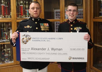 Capt. Matthew A. Lamb, Executive Officer of Recruiting Station Indianapolis presents the Naval Reserve Officer Training Corps Scholarship to Alexander J. Wyman. Scholarship selection is based on  commitments to the classroom, community and physical fitness.