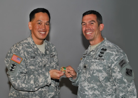 U.S. Army Corps of Engineers San Francisco District, Deputy Commander Lt. Col. Adam J. Czekanski, presents a district coin to thank the South Pacific Division Commander, Brig. Gen. Mark Toy for taking time to share both his personal and professional experiences as part of our Asian-Pacific American Heritance Month observance.