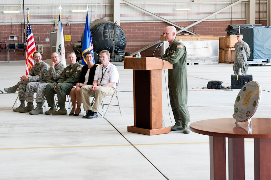 Col. Shaun Perkowski, 167th Airlift Wing commander, gives his remarks during a ceremony marking the end of a 52 year partnership between the 167th Airlift Wing and Lockheed Martin at the Martinsburg, W.Va. unit, May 19. Seated to the left are Chief Master Sgt. Ron Glazer, 167th Airlift Wing command chief, Col. Keith Snyder, 167th Maintenance Group commander, Lt. Col. Stuart Brown, 167th Operations Group deputy commander, Kim Mazur, left, program director for Lockheed Martin,  and Chuck LaFavre, Lockheed Martin Martinsburg C-5 systems engineer. The wing is in conversion from C-5 Galaxy aircraft to C-17 Globemaster III aircraft. The last C-5 assigned to wing departed May 20 for the 309th Aerospace Maintenance and Regeneration Group at Davis-Monthan Air Force Base. (photo by Master Sgt. Emily Beightol-Deyerle/released)