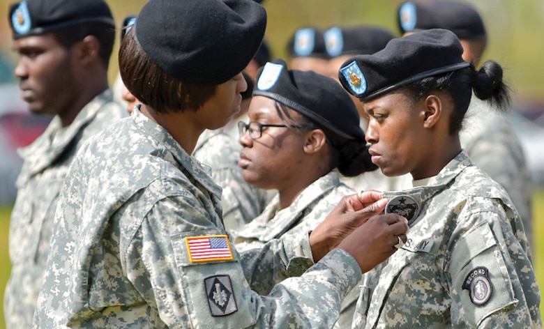 Soldiers of the 2nd Engineer Brigade, U.S. Army Alaska, change out their shoulder insignia for the USARAK insignia during a ceremony at Joint Base Elmendorf-Richardson May 15. This is the fourth time the 2nd Engineer Brigade has inactivated since World War II. The brigade is inactivating as part of downsizing to restructure into a leaner, more adaptable fighting force. (U.S. Air Force photo/Justin Connaher)
