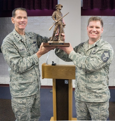 Lt. Gen. Stanley E. Clarke III, Air National Guard director, presents Senior Master Sgt. Thomas W. Egstad, 115th Fighter Wing occupational safety and health manager, with the ANG Director of Safety Outstanding Achievement Award at Volk Field Air National Guard Base, May6. (Submitted Photo)