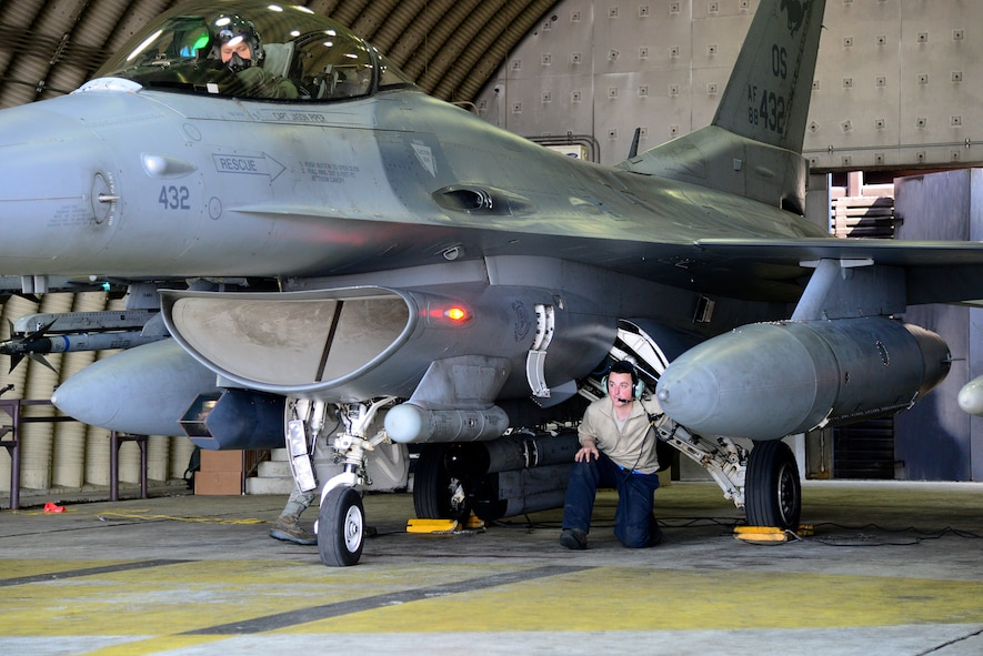 Senior Airman Joseph Dillon, 51st Maintenance Squadron crew chief, performs pre-flight checks with the pilot during Buddy Wing 15-3 March 26, 2015, at Osan Air Base, Republic of Korea. The program is intended to enhance the partnership between the United States and ROKAF. (U.S. Air Force photo by Senior Airman Matthew Lancaster)