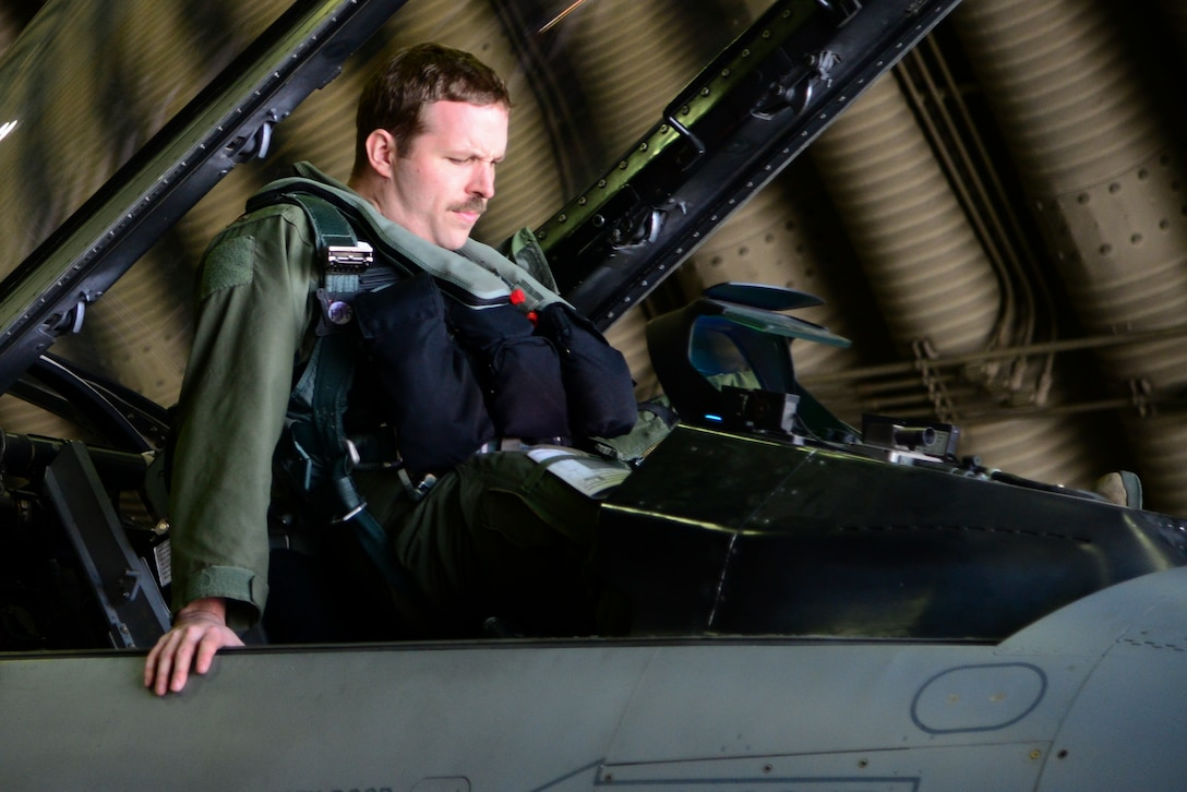 A 36th Fighter Squadron pilot gets into an F-16 Fighting Falcon during Buddy Wing 15-3 March 26, 2015, at Osan Air Base, Republic of Korea. During Buddy Wing, members from each air force share tactics and procedures to become familiar with how each other work during flying missions. (U.S. Air Force photo by Senior Airman Matthew Lancaster)