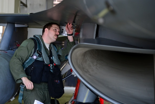 A 36th Fighter Squadron pilot does his pre-flight checks during Buddy Wing 15-3 March 26, 2015, at Osan Air Base, Republic of Korea. The purpose of the Buddy Wing program is to exchange ideas, introduce tactics and improve interoperability between the U.S. and Republic of Korea Air Forces. (U.S. Air Force photo by Senior Airman Matthew Lancaster)