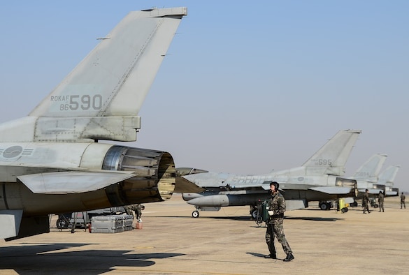 Republic of Korea air force crew chiefs prepare to marshal F-16 fighting Falcons during Buddy Wing 15-3 March 25, 2015, at Osan Air Base, ROK. The program is intended to enhance the partnership between the United States and ROKAF. (U.S. Air Force photo by Senior Airman Matthew Lancaster)