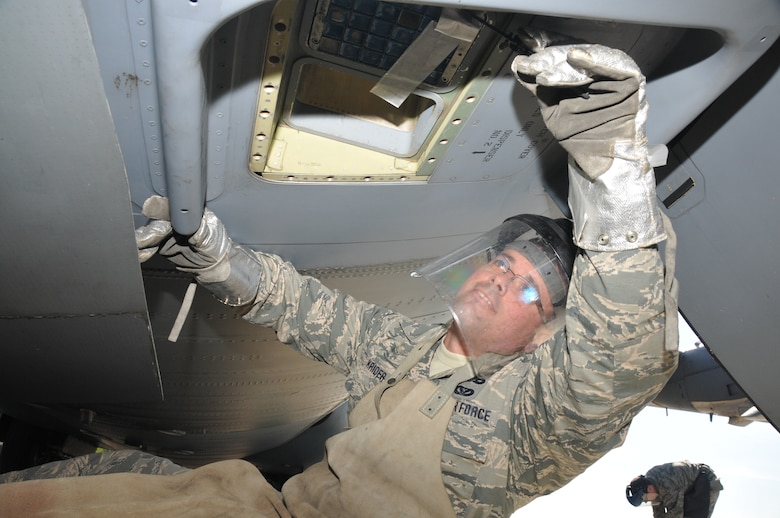 The non-commissioned officer in charge of operations, 104th Explosive Ordnance Disposal Flight, Barnes Air National Guard Base, Westfield, Mass., removes flares from a C-130 aircraft May 13, 2015, Ramstein Air Base, Germany. This was part of an EOD exercise and fulfilled their yearly aircraft-training requirement. (U.S. Air National Guard photo by 2nd Lt. Bonnie Harper/Released)