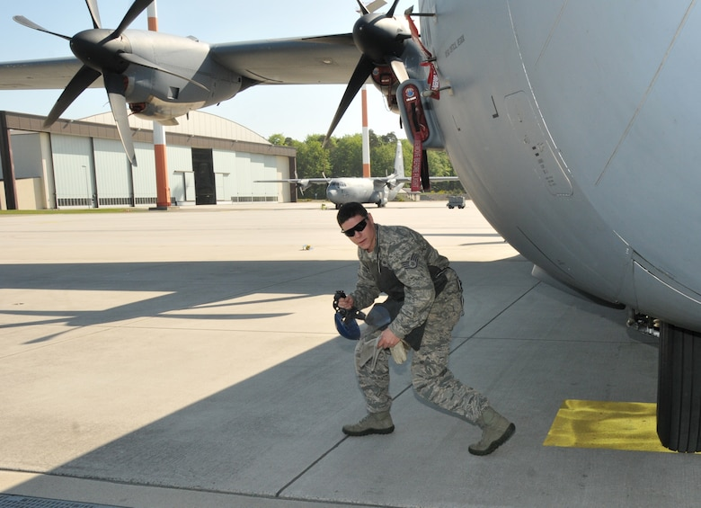 "The non-commissioned officer in charge of equipment, 104th Explosive Ordnance Flight (EOD), 104th Fighter Wing, Barnes Air National Guard Base, Westfield, Mass., walks around the C-130 aircraft prior to ""Safeing"" it, May 13, 2015, Ramstein, Air Base Germany. He is an emergency responder who will be qualified on ""Safeing"" the C-130 aircraft, making him more valuable to the 104th Fighter Wing and New England area. (U.S. Air National Guard photo by Tech. Sgt. Melanie J. Casineau/Released)"