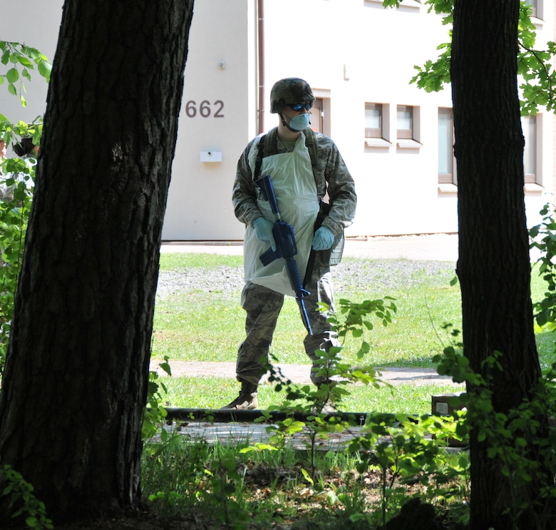 An Airman from the 104th Services Flight, Barnes Air National Guard Base, Westfield, Mass., waits to enter a wooded area for an expedient search and rescue training exercise, May 13, 2015, during Exercise Silver Flag, Ramstein Air Base, Germany. Silver Flag is a U.S. Air Force training course designed to educate airman with valuable skills allowing them to know how to deploy using real-world equipment in real-world scenarios. (U.S. Air National Guard photo by Tech. Sgt. Melanie J. Casineau/Released)