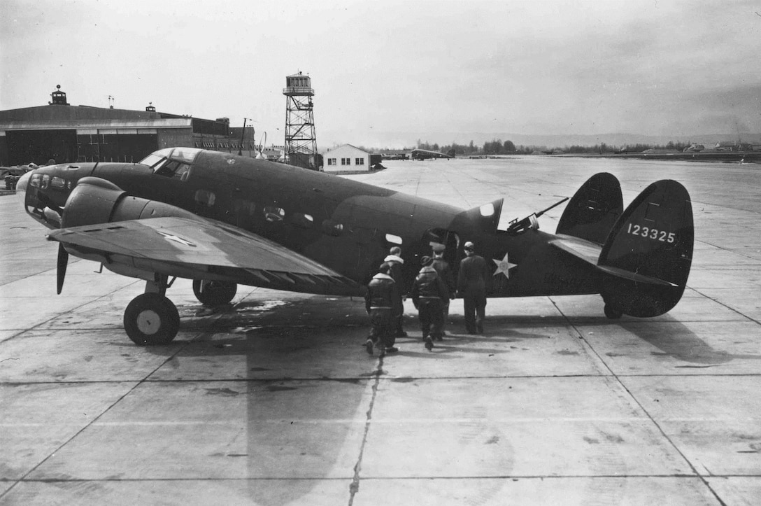 An aircrew, possibly of the 75th Bomb Squadron, prepares to board a USAAF Lockheed A-29, serial number 41-23325, at Portland Army Air Base, Oregon, circa 1942.  Note the semi-enclosed aerial gunner position at the top rear of the fuselage.  The aircraft's RAF serial number, BW463, is barely seen in shadow on the lower rear fuselage, a remnant of the original Lend-Lease contract for the aircraft.  (USAF Photo)