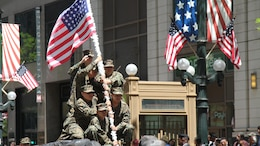 Junior Reserve Officer Training Corps students recreate the flag raising on Mount Suribachi as part of their float during the 2015 Chicago Memorial Day Parade May 23, 2015 in Chicago, Illinois. The annual parade is considered one of the largest in the nation and attracts thousands of visitors each year to remember those who have paid the ultimate sacrifice for American freedom.