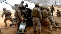 Marines assigned to India Battery, 3rd Battalion, 14th Marine Regiment show Moroccan Royal Armed Forces artillerymen their howitzer's capabilities during Exercise African Lion 15, 2015, near Tan Tan, Morocco.